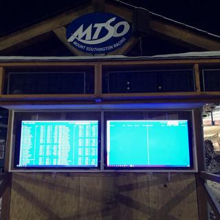 The scoreboard TV's in action outside on our awards stand.