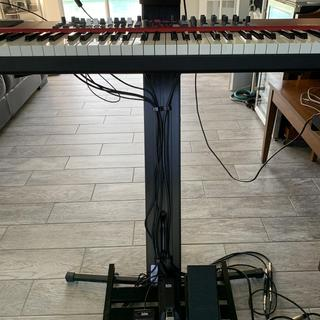 Keyboard station with foot pedals