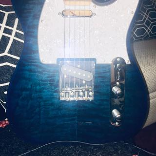 Front of Trans Blue Aqua Quilted Top  with a white  sparkle pickguard