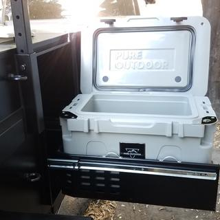 Perfect fit in the trailer's generator/fridge slide-out drawer.