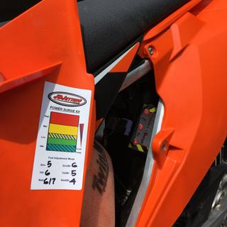 Both tuner and settings sticker are protected in the air box.
