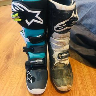 "White/black Tech 7S youth boot vs adult black/teal Tech 7. Adult is 14.5"" tall, youth is 13.5""."
