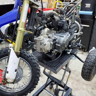 Getting the Yamaha TTR50 up to a decent working height to clean the carb.
