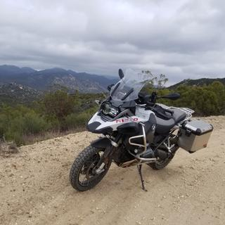 Combination gravel, sand, rocks and road. Holds pretty good.