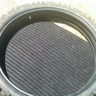 Squeeze the tube and tube saddle into the tire.