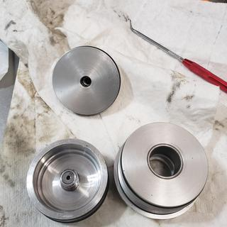 The tool is required to remove and reinstall the floating piston pictured here.