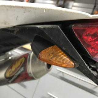Soldered onto factory wiring, drilled 2 holes and mounted adjacent to brake light.