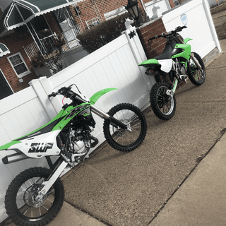 Polisport Replica Kit on a 2008 KX100 on the right