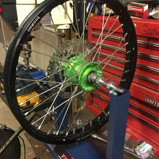 Bought the Tusk wheel truing stand along with a new Tusk hoop and spokes and it worked out great!