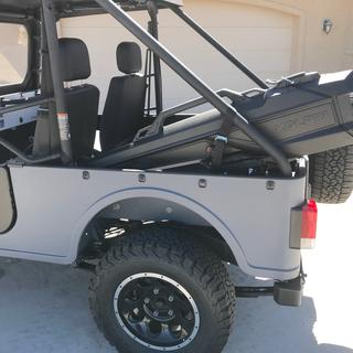 If the Roxor had a cross member on the roll cage, I would have mounted the Gun Boot there.