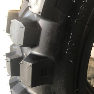 Large tall lugs with varied spacing works well in mud and pavement