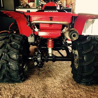 "Kenda Bear Claw rear tires, ITP 8"" Steel Wheels."