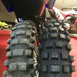 Stock tire compared to the tusk recon hybrid.