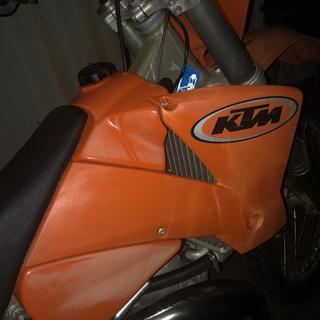 Before SC1, faded plastic. Makes the bike look bad.
