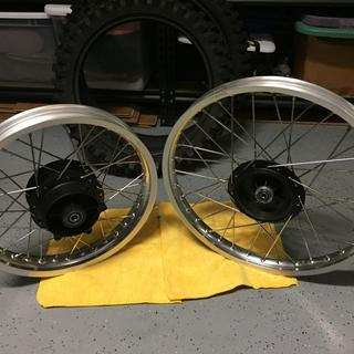 Front and rear Tusk wheels laced with Bulldog spokes for my 78 RM125.