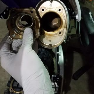 Silencer from exhaust (DO NOT remove the spark arrestor, USFS requires it!)