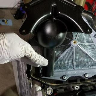 Snorkle from air box (backfire mesh is reinstalled in the picture, the black snorkle is under it)