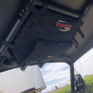 Over head storage is worth having along with the between the seats storage,added a photo of each