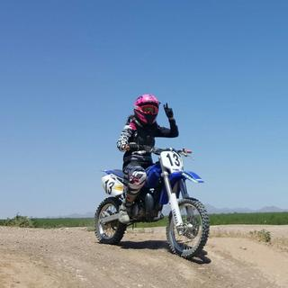 My 14 year old daughter on her YZ85.