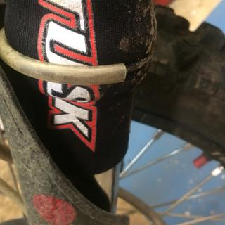 Add 3/16 ID plastic tubing to zip tie to protect Seal protector from fork guards works real good