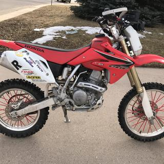 Crf150rb with extended 1.7g tank w/reserve. Stock tank is 1.1 with no reserve
