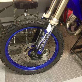 Black Tusk spokes. Wheel is powder coated in Bentley Blue.