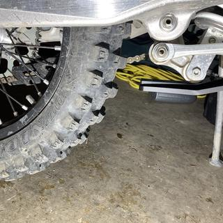 """About 1.5-2"""" from back of plate to tire."""