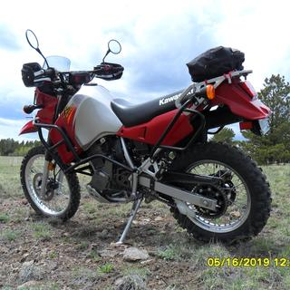 Dunlop D606 handles all the mountain trails and dirt roads well.