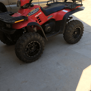 2001 Polaris Sportsman with ITP Hurricanes and ITP Mudlites Tricked it up a touch.