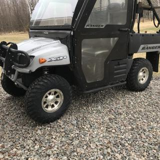 Side view of Polaris UTV  with set of 4 new tires.