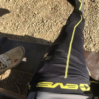 EVS knee brace sock works well under my Leatt c-frame brace. I can fold it over the top.