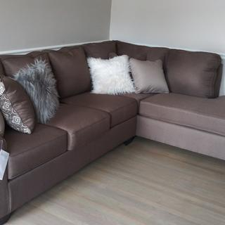 Love this sectional. Cute, soft, cleanable material.