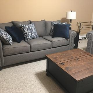 The couches are comfe and the look is great!?? The table is a great piece to this room.
