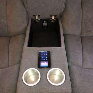 Center console with 2 USB and outlet plugs; insulated cup holders