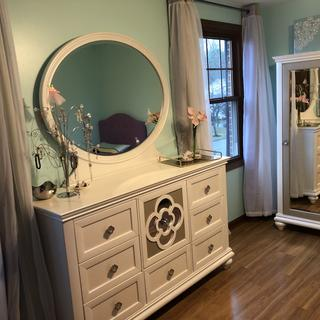 Dresser with drawer panels flipped to white side; door chest in background.
