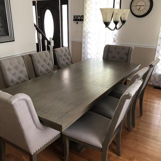 It has a tint of olive color. I purchased to additional chairs and added the leaf to the table.