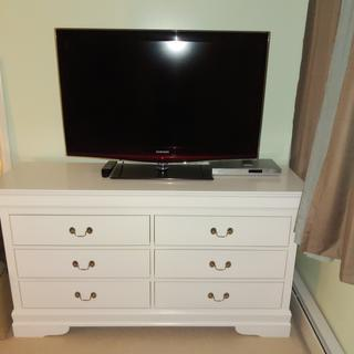 Very nice quality dresser..fits a 40inch tv and decent drawer space.