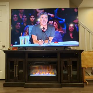 Love my new TV stand electric fireplace.  Holds a 75 inch TV perfectly.