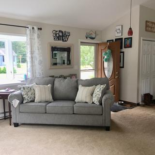 Exactly as pictured on the website! Great couch and the perfect addition to our family room.
