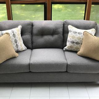 I enjoy ?? my new couch in my sunroom.