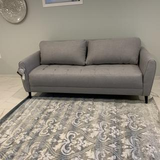 The color matches my apartment. This couch is perfect for smaller living rooms.
