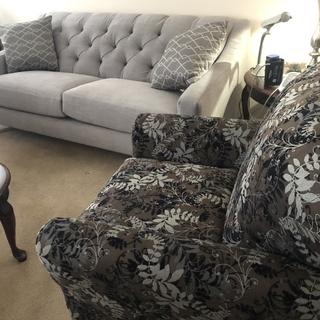 This sofa is awesome. Not a soft seat but comfy. Looks amazing especially with that chair!!!!