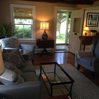 large love seat along with 2 chairs, 2 lamps , side table and rug to make this old house come alive!