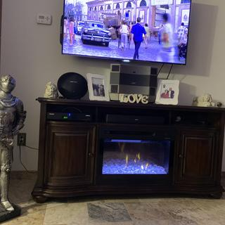 I love my new fireplace TV stand thank you Raymore and Flanigan