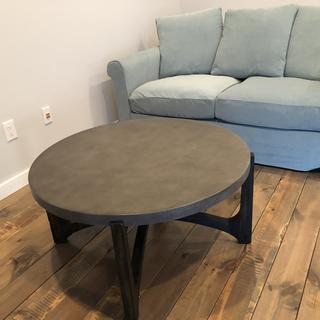 This coffee table fits perfectly in our space and looks beautiful on our hardwood floors.