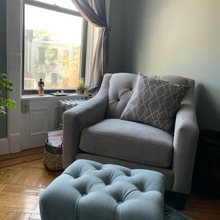 I love the matching chair. It is wider than the average chair. My ottoman from Target matches too!