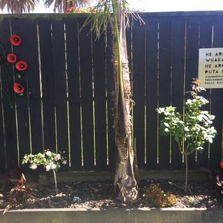 The wall art looks so good on my black fence behind my roses