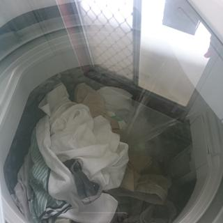 Photo of washing being done taken from outside its glass window
