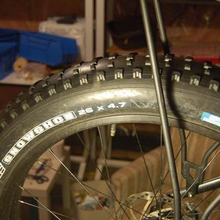 The tire is not even worn - the rubber knobs are like new.