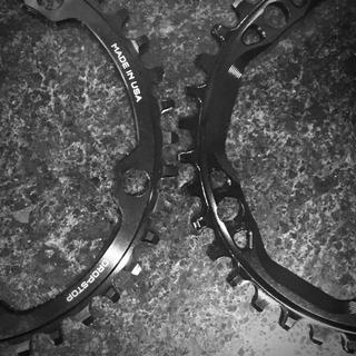 Comparison of a Wolf Tooth 38t chainring on left, with an Absolute Black 38t CX ring on the right.